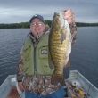 """Kevin Grosser with a personal best 21"""" Smallmouth Bass from Marchington Lake"""